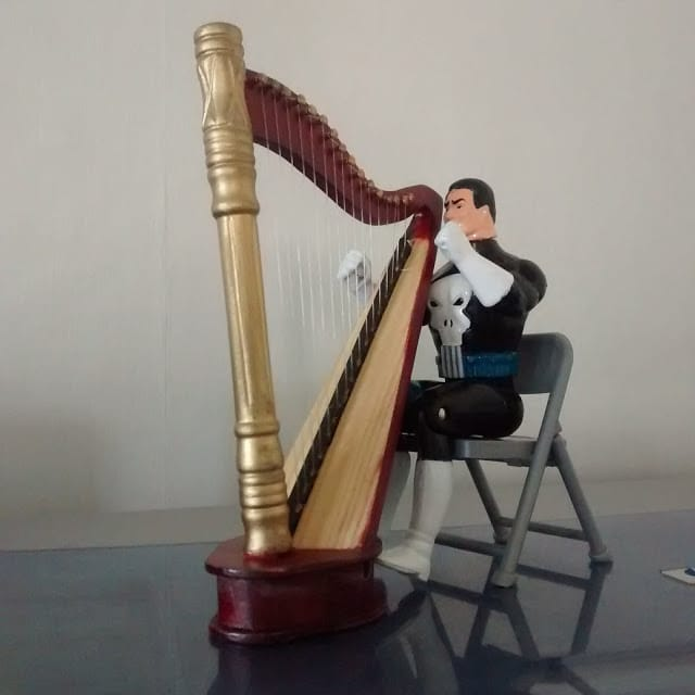 Talking Punisher with his new harp.