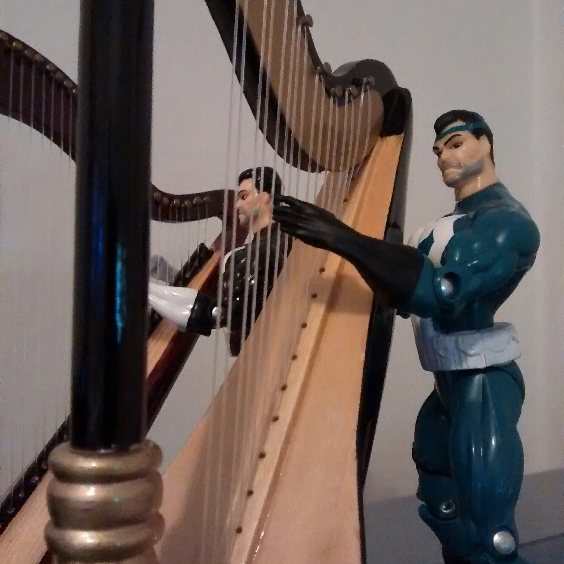 Frank's very pleased with the harp's sound.