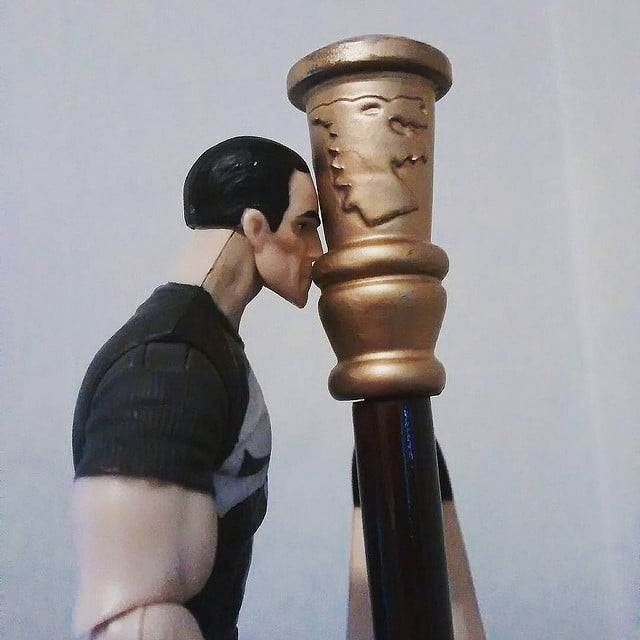 Punisher's kissing his harp.