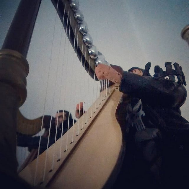 Inspired by harp playing photos taken with smartphones.