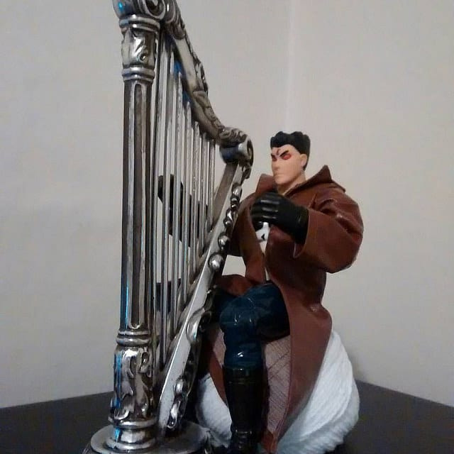 The Avenging Angel Punisher playing the silver harp.