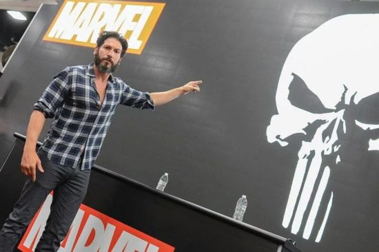 Jon Bernthal pointing to the most badarse symbol ever!
