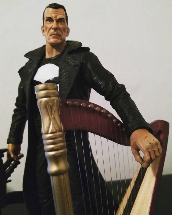 Punisher resting with his harp.