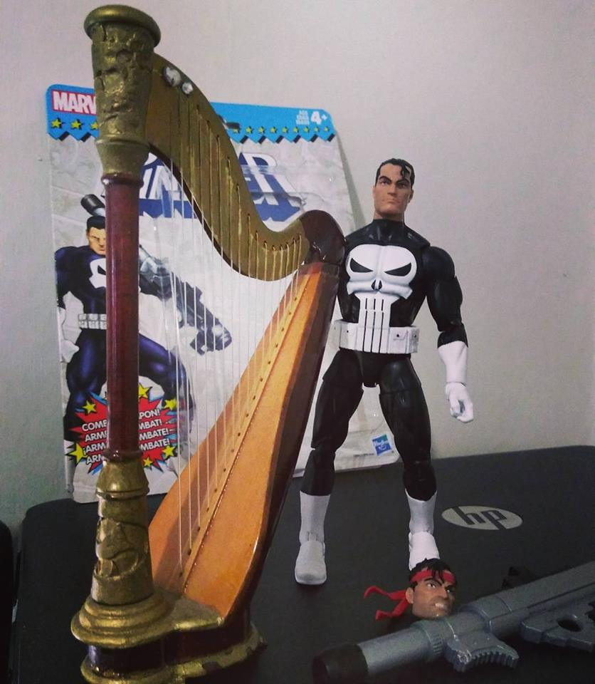 Here's The Punisher standing right next to a harp I provided for him.